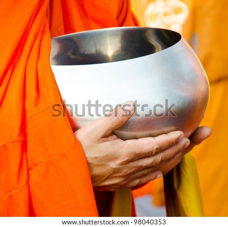 Buddhist merit. monk s alms bowl - stock photo