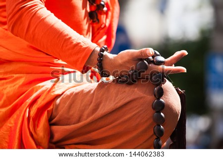 Buddhist monk hand detail, the monk in praying. - stock photo