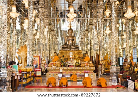 buddhist monks pray to buddha at big temple thailand - stock photo