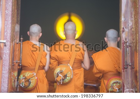 buddhist monks pray to in Thai temple - stock photo