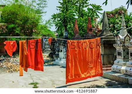 Buddhist monks' robes hanging to dry in Vientiane, Laos - stock photo