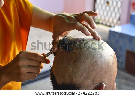Buddhist monks shave their hair to be ordained a priest.  - stock photo