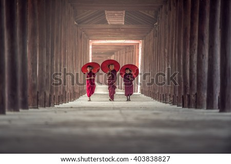Buddhist novice are walking in temple, Myanmar - stock photo