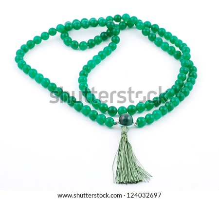 Buddhist Prayer Beads, from gem on white background - stock photo