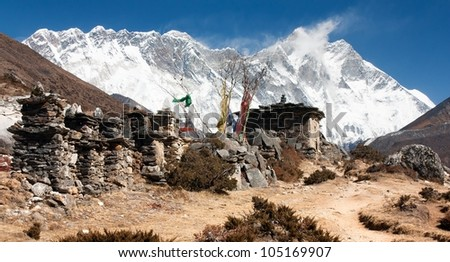 buddhist prayer walls or prayer stupas in nepal on the way to everest base camp - Lhotse, Nuptse and top of Mount Everest - stock photo