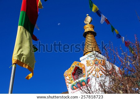 Buddhist stupa in the mountains - stock photo