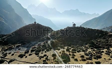 Buddhist stupas on the hilltops - Everest region, Nepal, Himalayas - stock photo