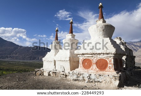 Buddhist Stupas overlooking the Shyok river at Diskit, Nubrah Valley, Ladakh, Northern India - stock photo