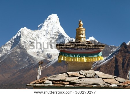 Buddhist Temple - detail of roof with mount Ama Dablam - Nepal - stock photo