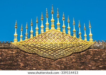 Buddhist Temple roof decoration in Luang Prabang, Laos, Asia - stock photo
