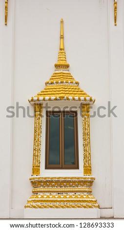 Buddhist temple window sculpture in Thailand - stock photo