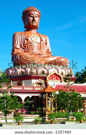 Buddhist temple with a huge monument. - stock photo