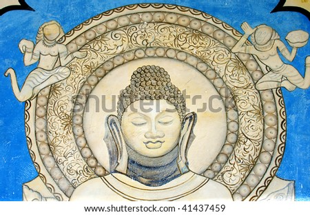 Buddhist wall figure near temple in Sarnath, Varanasi, India. - stock photo