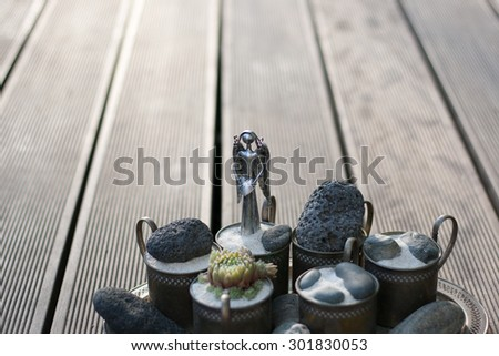 buddhistic still life with angel and stones and houseleek flower and sand and tiny rocks in zen style - stock photo