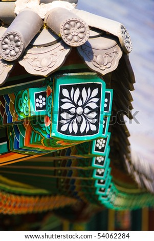 Buddhistic temple roof ornament - stock photo