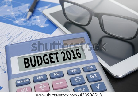 BUDGET 2016 Calculator  on table with Office Supplies. ipad - stock photo