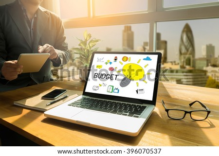 BUDGET concept Thoughtful male person looking to the digital tablet screen, laptop screen,Silhouette and filter sun - stock photo