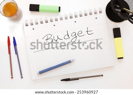 Budget - handwritten text in a notebook on a desk - 3d render illustration. - stock photo