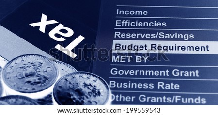 Budget structure and tax surrounded by coins - stock photo