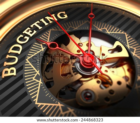 Budgeting on Black-Golden Watch Face with Closeup View of Watch Mechanism. - stock photo