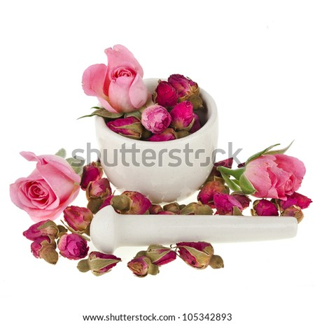buds of the tea roses flowers in a mortar and pestle - stock photo