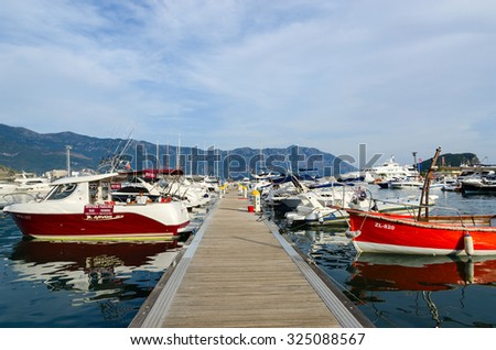 BUDVA, MONTENEGRO - SEPTEMBER 15, 2015: Pleasure boats and yachts at the pier on the waterfront of the popular resort of Budva, Montenegro - stock photo