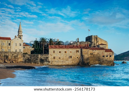 Budva Old Town is washed by waves. Stari grad Budva je pere talasa - stock photo
