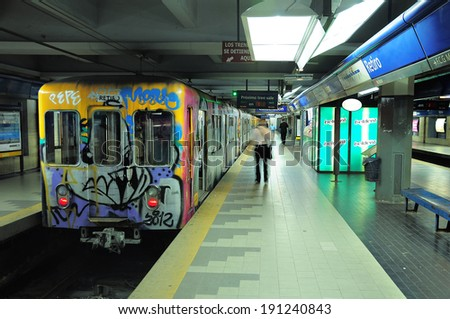 BUENOS AIRES, ARGENTINA-APRIL 11: Metro train stands by the platform on Retiro station on April 11, 2013 in Buenos Aires, Argentina. Metro of Buenos Aires is more then 100 years age. - stock photo