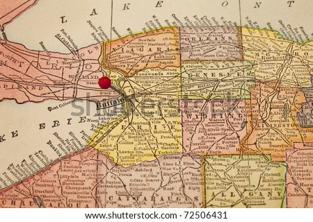 Buffalo and part of New York state on vintage 1920s map with a red pushpin, selective focus (printed in 1926 - copyrights expired) - stock photo
