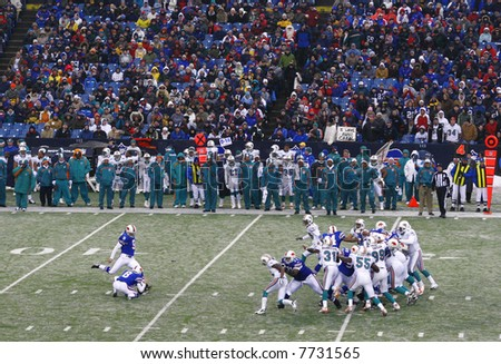 Buffalo Bills performing a kick against Miami Dolphins at the Ralph Wilson Stadium, December 9, 2007 - stock photo