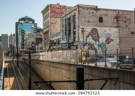 BUFFALO, NEW YORK - JUNE 3, 2015: Looking south down Main Street in downtown Buffalo, New York over a transit tunnel. The iconic Shea's Buffalo sign visible. - stock photo