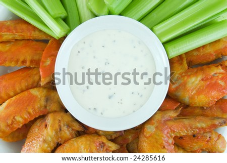 Buffalo wings, celery and blue cheese dressing - stock photo