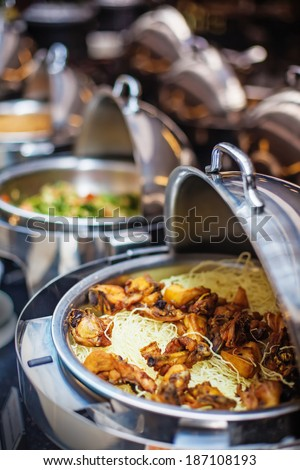 Buffet dinner (soft focus on the piece of chicken) - stock photo