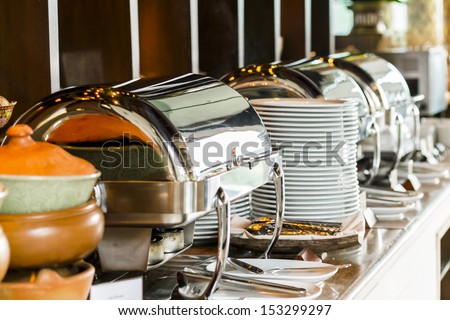 Buffet heated trays ready for service - stock photo
