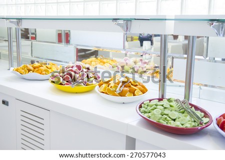 Buffet style salad in trays at restaurant. Fresh, healthy food. - stock photo