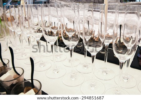 Buffet table close-up. Champagne glasses. - stock photo