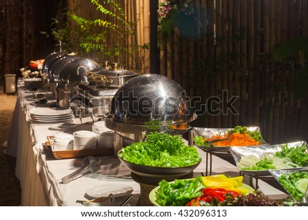 Buffet Table with Row of Food Service Steam Pans. - stock photo