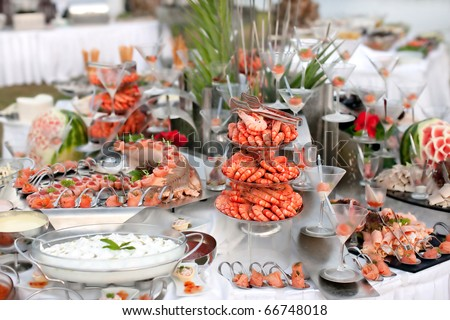 Buffet table with seafood with shrimp in the foreground - stock photo
