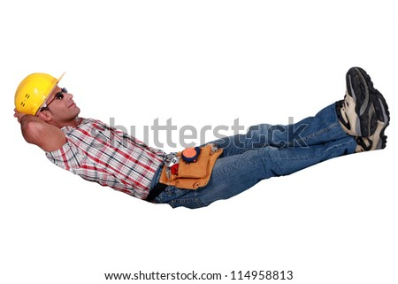 Builder chilling-out - stock photo