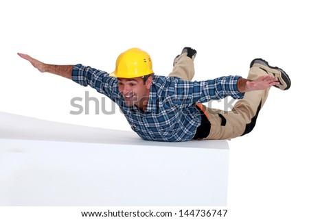 Builder free-falling - stock photo