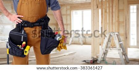 Builder handyman in new house. - stock photo
