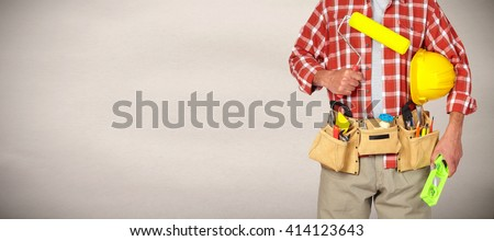 Builder handyman with paint roller. - stock photo