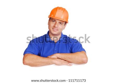 Builder holding  the blank board horizontal portrait - stock photo