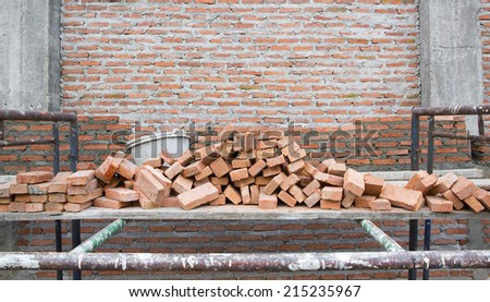builder laying bricks in site Background of brick wall texture - stock photo