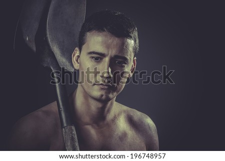 Builder.Male worker holding a shovel, sexy builder - stock photo