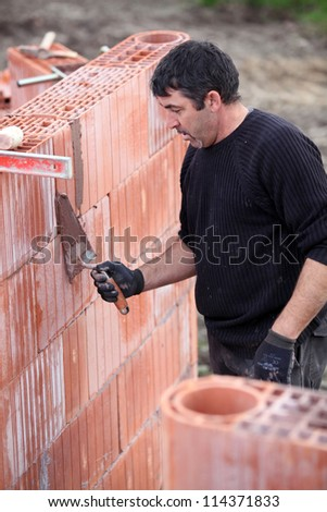 Builder on site - stock photo
