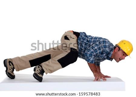 Builder pushing - stock photo