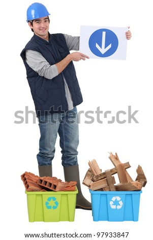 Builder stood with recyclable waste - stock photo