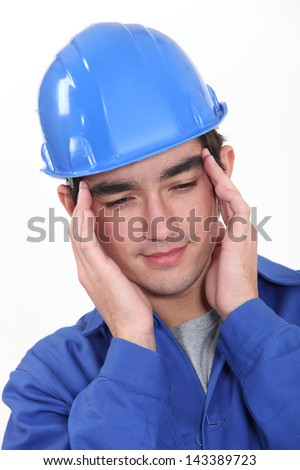Builder suffering from tension headache - stock photo
