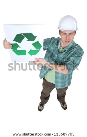 Builder with a recycling logo - stock photo